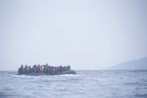 Refugees on a boat crossing the Mediterranean sea, heading from Turkish coast to the northeastern Greek island of Lesbos, 29 January 2016.