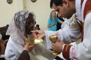 dona_penha_101_receives_first_communion_credit_our_lady_of_mount_carmel_nursing_home_cna
